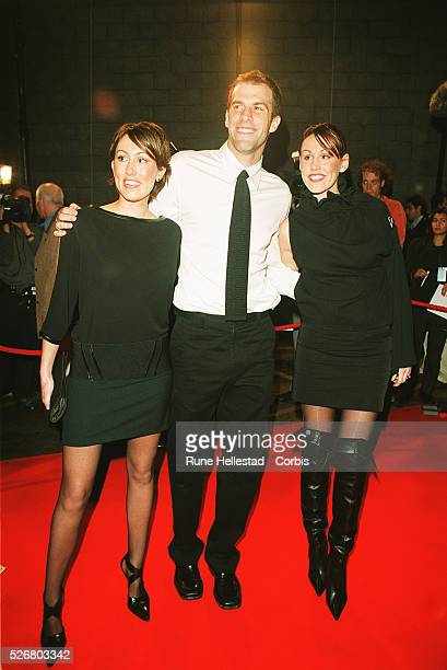 """Tennis player Greg Rusedski, his wife, and a friend attend the """"Top of the Pops"""" awards at the Manchester Arena."""