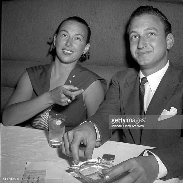 Tennis Player Gussie Moran and friend Ralph Fields at a table in Mocambo in Los AngelesCA