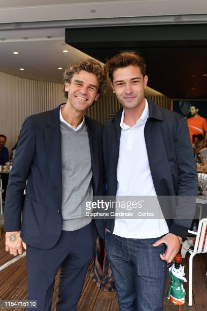 Tennis Player Gustavo Kuerten and Model Francisco Lachowski attend the 2019 French Tennis Open - Day Fourteen at Roland Garros on June 08, 2019 in...