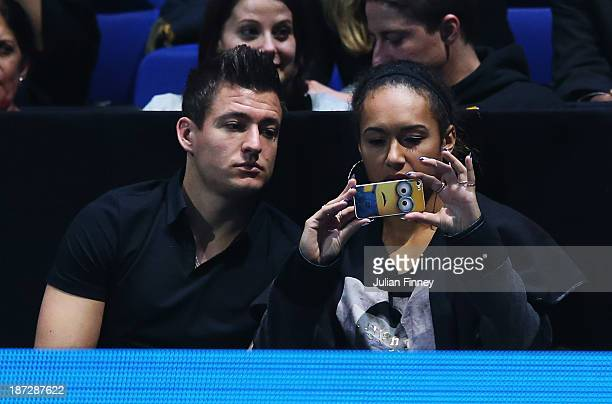 Tennis player Heather Watson of Great Britain takes a photo as she watches the men's singles match between Novak Djokovic of Serbia and Juan Martin...