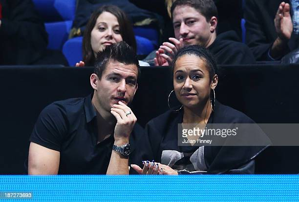 Tennis player Heather Watson of Great Britain watches the men's singles match between Novak Djokovic of Serbia and Juan Martin Del Potro of Argentina...