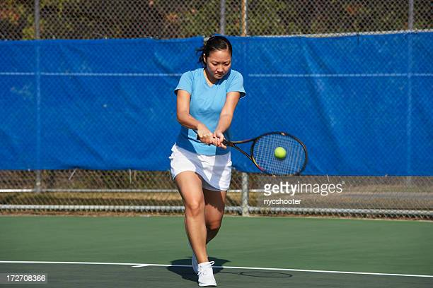 tennis player hitting backhand - match point scoring stock pictures, royalty-free photos & images