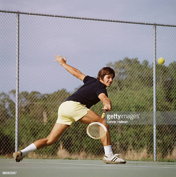 Tennis player hitting ball with backhand swing