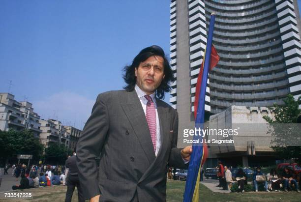 Tennis player Ilie Nastase participates in a protest against the government in Bucharest's University Square Ion Iliescu took over the provisional...