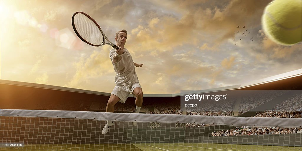 Tennis Player in Mid Air Volley : Stock Photo
