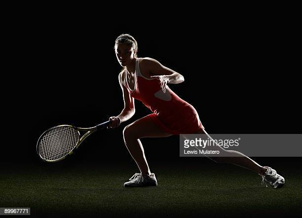 tennis player in receiving position - back lit stock pictures, royalty-free photos & images