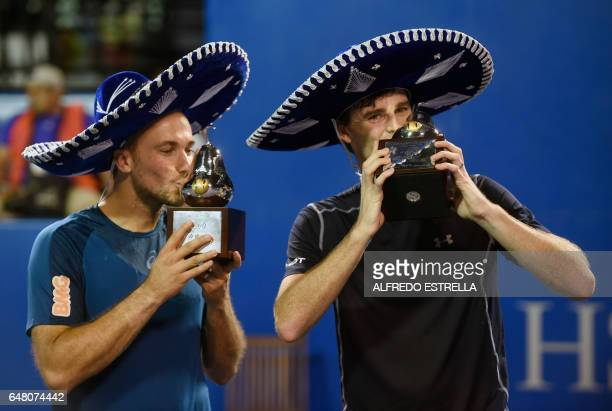 Tennis player Jamie Murray and Brazilian tennis player Bruno Soares kiss their trophies after winning the Mexican Tennis Open doubles final match...