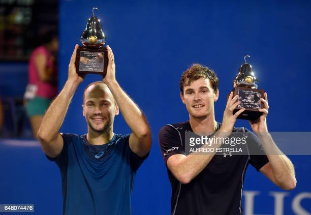 Tennis player Jamie Murray and Brazilian tennis player Bruno Soares hold up their trophies after winning the Mexican Tennis Open doubles final match...