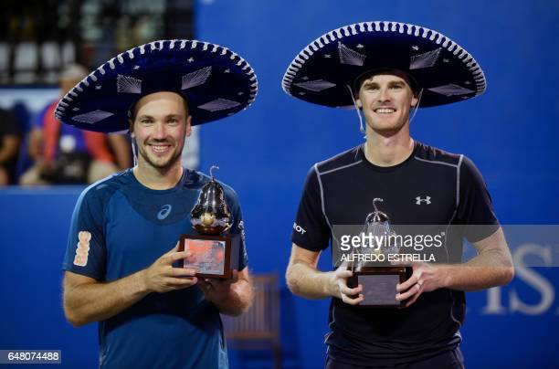 Tennis player Jamie Murray and Brazilian tennis player Bruno Soares pose with their trophies after winning the Mexican Tennis Open doubles final...