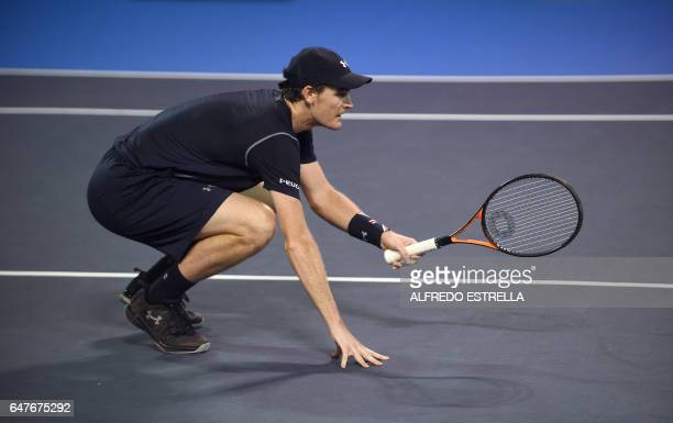 Tennis player Jamie Murray awaits the ball of Germany tennis player Philipp Petzschner and Pakistani tennis player Aisam-Ul-Haq Qureshi during the...