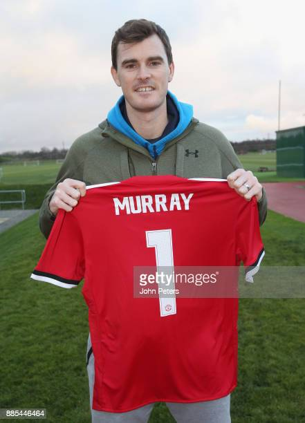 Tennis player Jamie Murray poses with a Manchester United shirt at Aon Training Complex on December 4 2017 in Manchester England