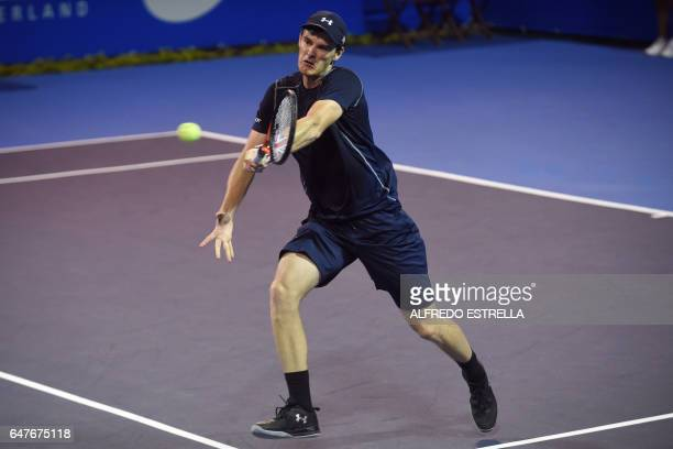 Tennis player Jamie Murray returns the ball to Germany tennis player Philipp Petzschner and Pakistani tennis player Aisam-Ul-Haq Qureshi during the...