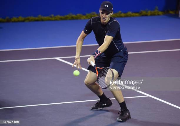 UK tennis player Jamie Murray returns the ball to Germany tennis player Philipp Petzschner and Pakistani tennis player AisamUlHaq Qureshi during the...