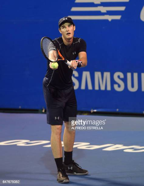 UK tennis player Jamie Murray serves to Germany tennis player Philipp Petzschner and Pakistani tennis player AisamUlHaq Qureshi during the doubles...