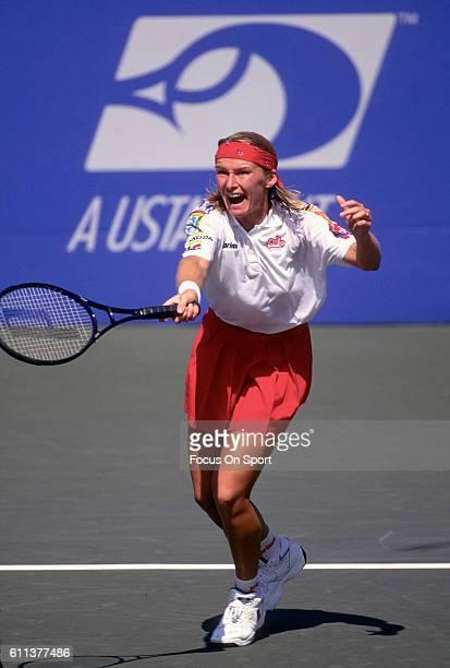 Tennis player Jana Novotna of Czech Republic hits a return during the women 1995 US Open Tennis Tournament at the USTA National Tennis Center in the...