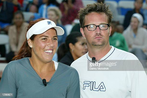 Tennis player Jennifer Capriati and actor Matthew Perry pose during the the JPMorgan Chase Open at Manhattan Beach Country Club on August 4 2002 in...