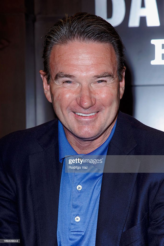 Tennis player Jimmy Connors signs copies of his book 'The Outsider' at Barnes & Noble bookstore at The Grove on May 22, 2013 in Los Angeles, California.