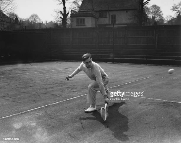 Tennis player John Barrett in action on the court 1951