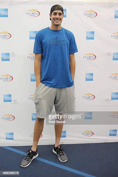 Tennis player John Isner attends The American Express Fan Experience at The 2015 US Open featuring 'You Vs Sharapova' Virtual Reality Experience and...