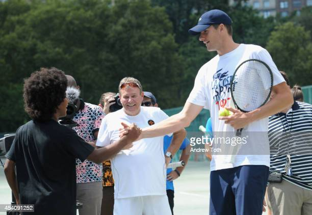Tennis Player John Isner greets a fan during the City Parks Foundation's tennis clinic at the Central Park Tennis Center on August 24 2014 in New...