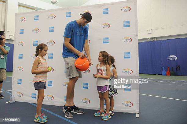 Tennis player John Isner speaks with fans at The American Express Fan Experience during The 2015 US Open at USTA Billie Jean King National Tennis...