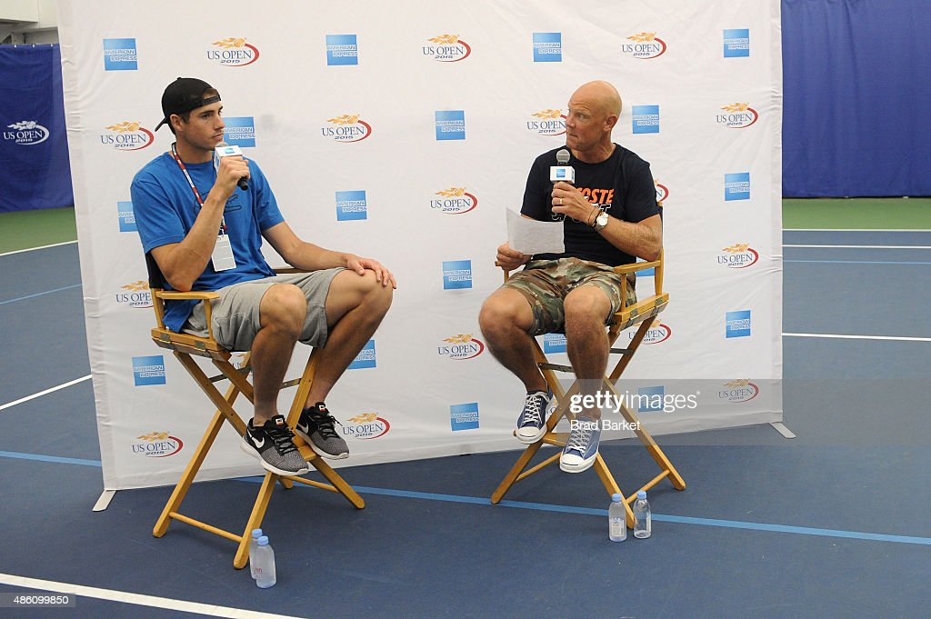 Tennis player John Isner speaks with Murphy Jensen at The American Express Fan Experience at The 2015 US Open featuring 'You Vs. Sharapova' Virtual Reality Experience and American Express Fan Court at USTA Billie Jean King National Tennis Center on August 31, 2015 in New York City.