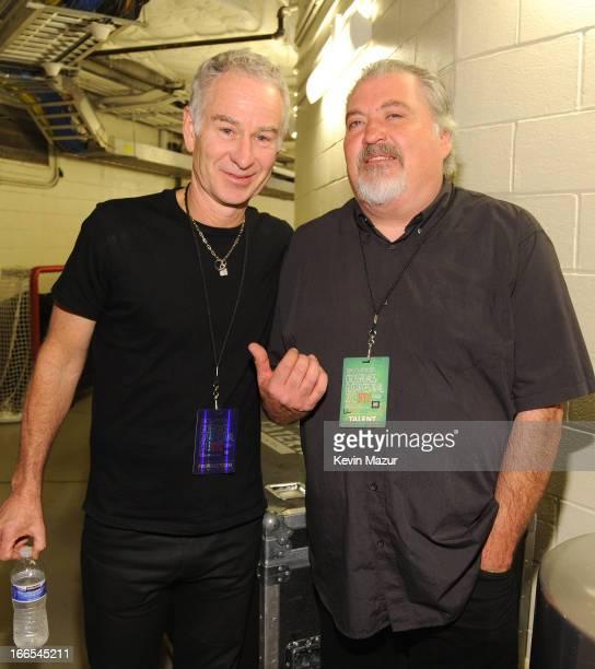 Tennis player John McEnroe and musician David Hidalgo of los Lobos pose backstage during the 2013 Crossroads Guitar Festival at Madison Square Garden...