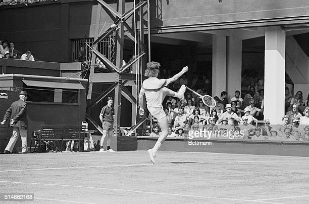 Tennis player John McEnroe kicks his racket around the court after arguing with the umpire during a match at Wimbledon