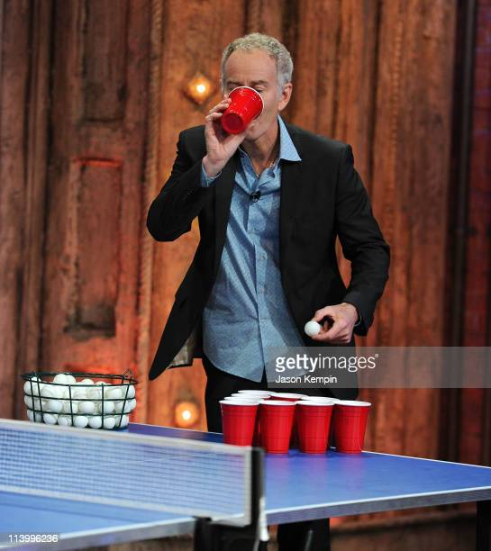 Tennis player John McEnroe plays beer pong on the 'Late Night With Jimmy Fallon' at Rockefeller Center on May 10 2011 in New York City