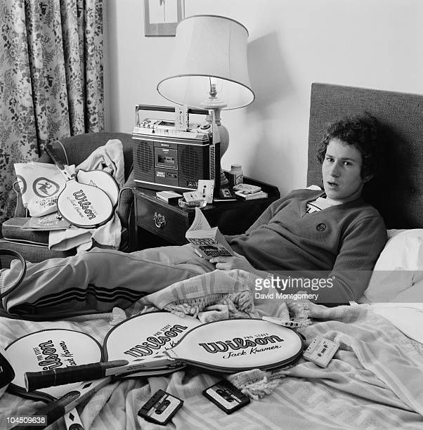 US tennis player John McEnroe relaxes with a tape player a Robert Ludlum novel and a selection of Wilson rackets 1979