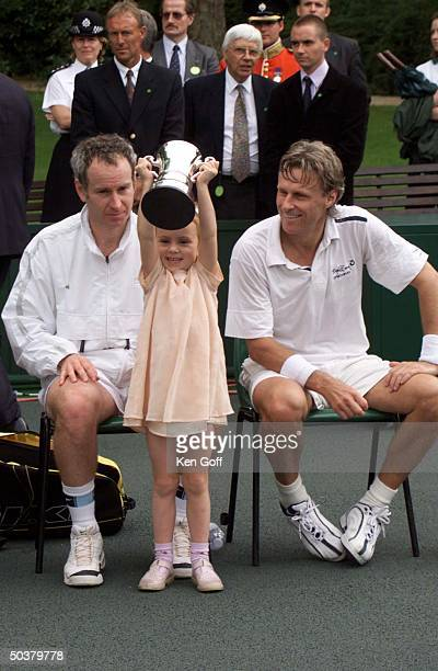 Tennis player John McEnroe w daughterAnna opponent Bjorn Borg at charity tennis event at Buckingham Palace for the National Society for the...