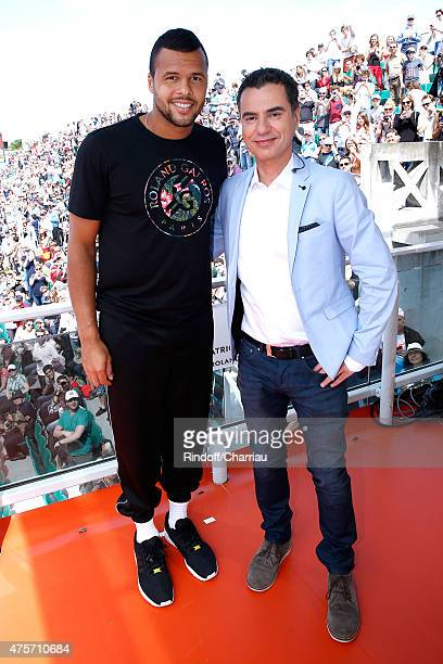 Tennis Player Jo-Wilfried Tsonga and Sports journalist Laurent Luyat pose at France Television french chanel studio during the 2015 Roland Garros...