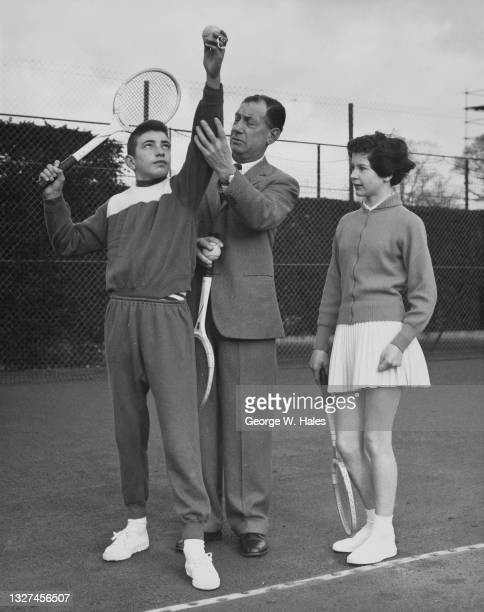 Tennis player Joyce Barclay looks on as 13 year old Stanley Matthews of Great Britain, son of professional footballer for Blackpool Football Club,...