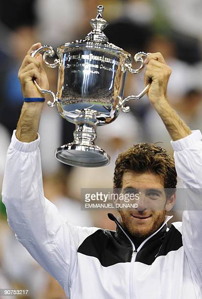 Tennis player Juan Martin Del Potro from Argentina holds his trophy after beating Roger Federer from Switzerland during the final of the 2009 US Open...