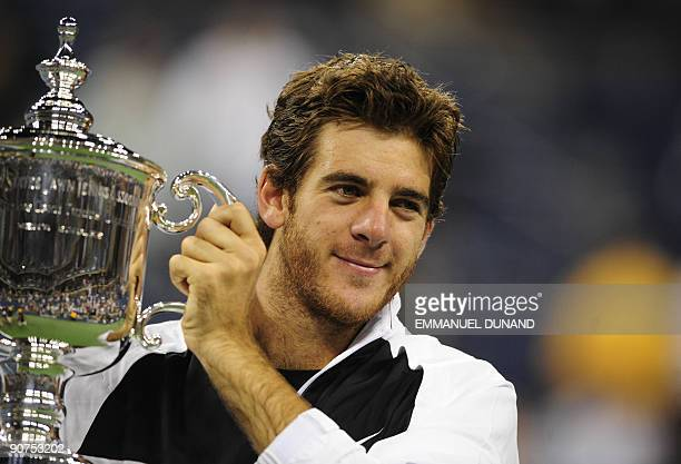Tennis player Juan Martin Del Potro of Argentina holds his trophy after beating Roger Federer of Switzerland in the final of the 2009 US Open at the...