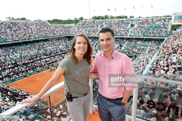 Tennis player Justine Henin and Sports Journalist Laurent Luyat pose at France Television french chanel studio during the 2018 French Open - Day One...
