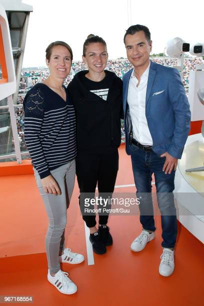 Tennis player Justine Henin Tennis player Simona Halep and Sports Journalist Laurent Luyat pose at France Television french chanel studio during the...