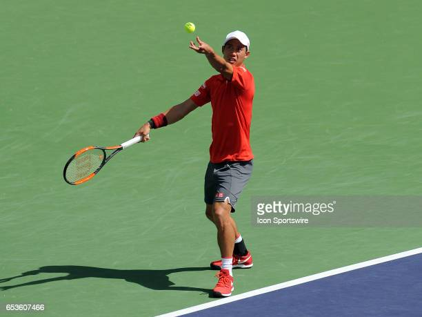 ATP tennis player Kei Nishikori serving during a match against Donald Young on March 15 during the BNP Paribas Open tournament played at the Indian...