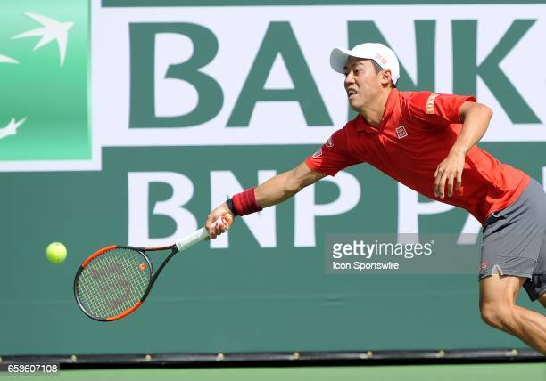 ATP tennis player Kei Nishikori stretches for the ball during the second set of a match against Donald Young on March 15 during the BNP Paribas Open...