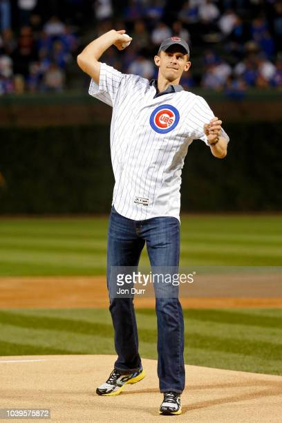 Tennis player Kevin Anderson throws out a ceremonial first pitch before the game between the Chicago Cubs and the Pittsburgh Pirates at Wrigley Field...