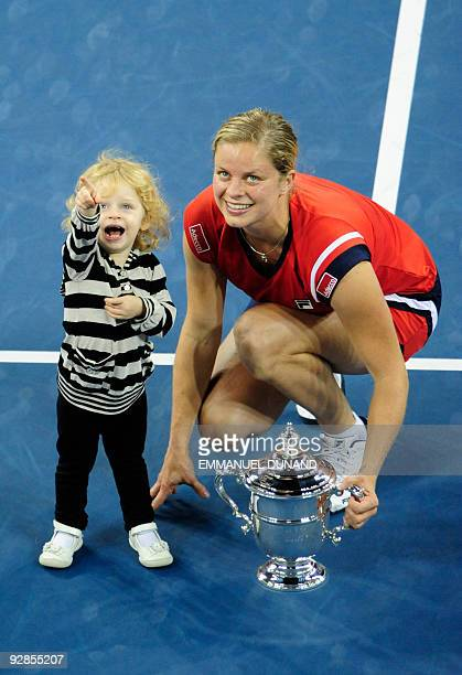 Tennis player Kim Clijsters from Belgium is joined by her daughter Jada after winnings against Caroline Wozniacki from Denmark during the Women's...