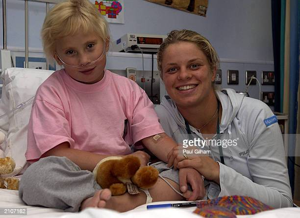 Tennis player Kim Clijsters of Belgium with patient Ditte Jensen, aged 8, at the Great Ormond Street Hospital on June 24, 2003 in London. Clijsters...