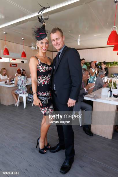 Tennis player Lleyton Hewitt and wife Bec Hewitt attend Melbourne Cup Day at Flemington Racecourse on November 5 2013 in Melbourne Australia