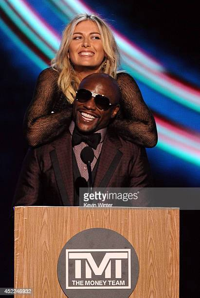 Tennis player Maria Sharapova and boxer Floyd Mayweather Jr speak onstage during the 2014 ESPYS at Nokia Theatre LA Live on July 16 2014 in Los...