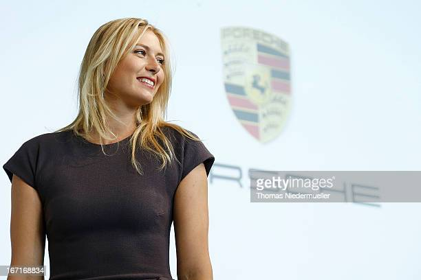 Tennis player Maria Sharapova poses for the media as she is unveiled as car manufacturer Porsche's new brand ambassador at the Porsche Museum on...
