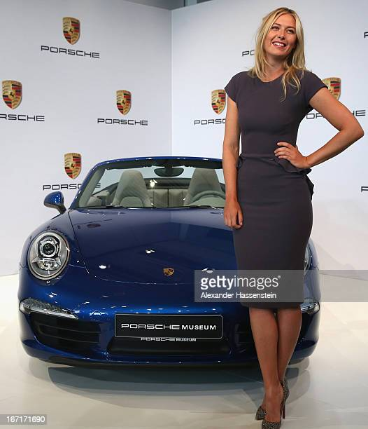 Tennis player Maria Sharapova poses for the media next to a Porsche 911 Carrera 4 Cabriolet as she is unveiled as car manufacturer Porsche's new...