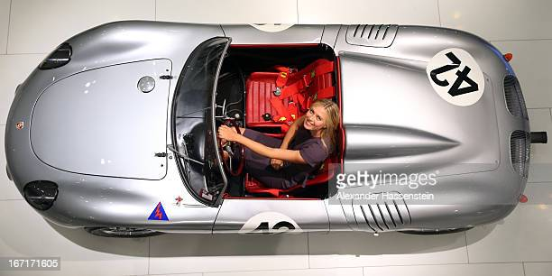 Tennis player Maria Sharapova poses in a Porsche 718 RS 60 Spyder at the Porsche Museum on April 22 2013 in Stuttgart Germany