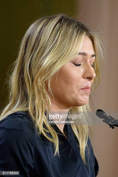 Tennis player Maria Sharapova reacts as she addresses the media regarding a failed drug test at The LA Hotel Downtown on March 7 2016 in Los Angeles...