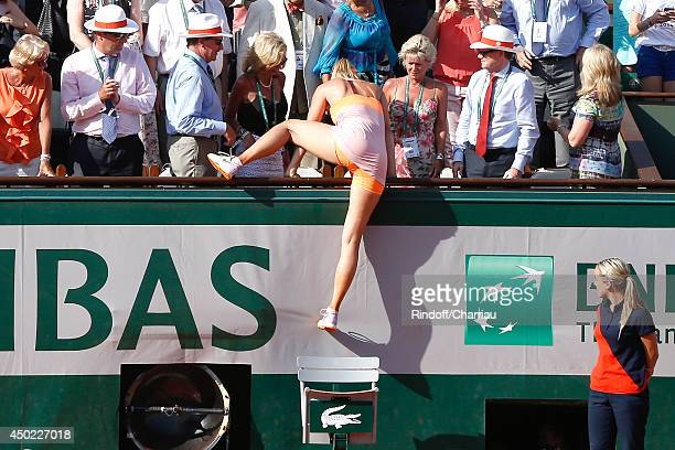 Tennis player Maria Sharapova wins the Roland Garros French Tennis Open 2014 Day 14 on June 7 2014 in Paris France She clims in tribunes to hole her...