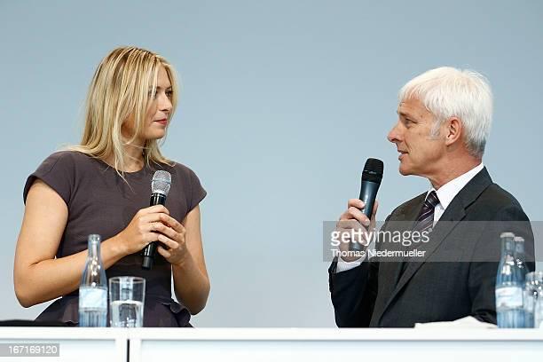 Tennis player Maria Sharapova with Matthias Mueller CEO of Porsche AG as she is unveiled as car manufacturer Porsche's new brand ambassador at the...